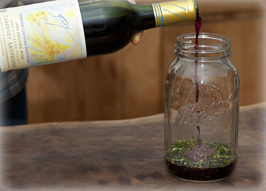 Pouring wine into the herbs