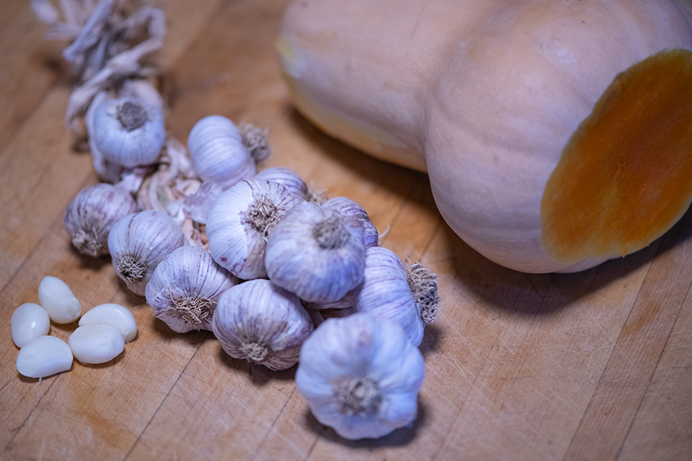 Peeled garlic and squash