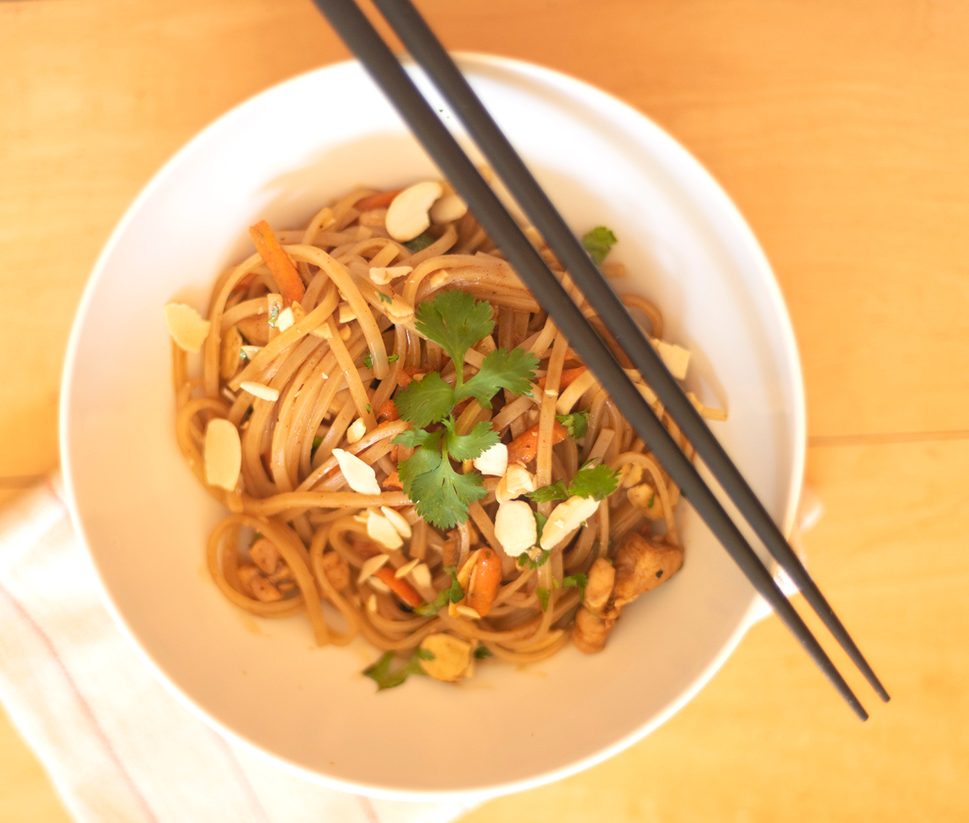 Sweet and Spicy Thai noodles in a bowl with chopsticks