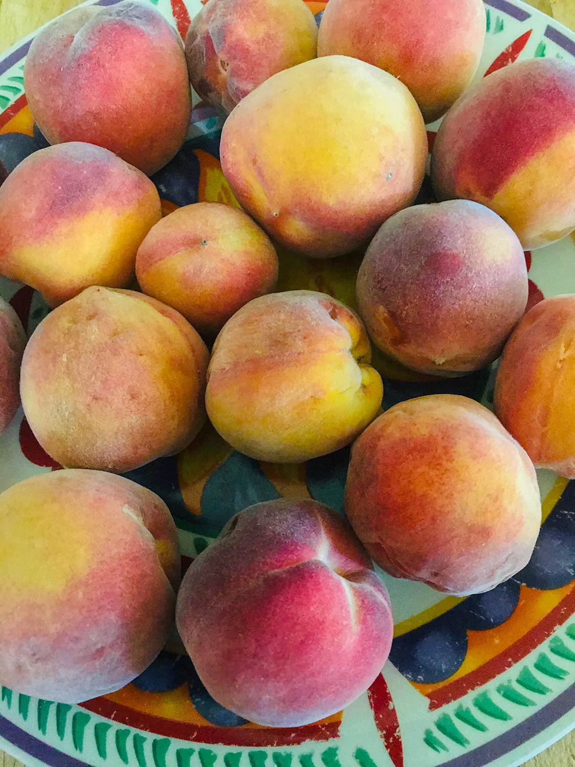 Fresh peaches in a dish