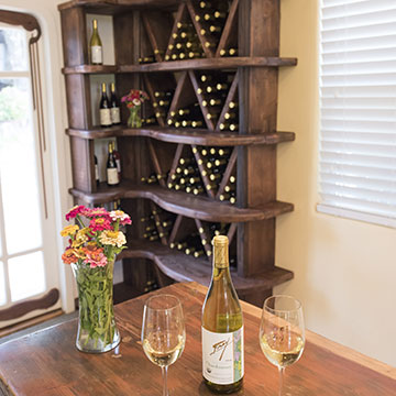 Wine on table and in shelf